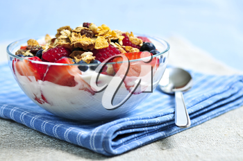 Serving of yogurt with fresh berries and granola