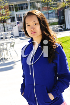 Young korean woman at outdoor mall in blue hoodie