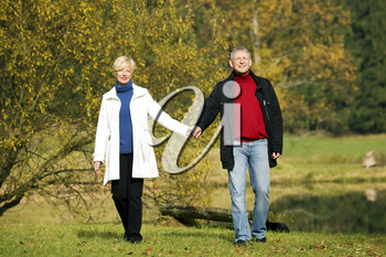 Mature couple having a walk holding each other tight still in love with each other