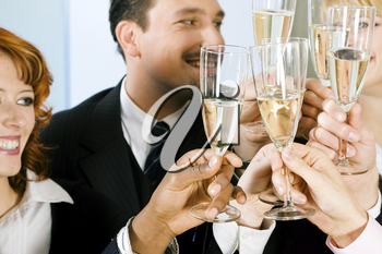 Group of people having a toast or party with champagne standing together