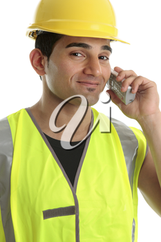 A builder, labourer, tradesman, using a cordless telephone and smiling in a friendly manner.  White background.