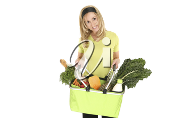 A girl holding an eco shopping bag holding a selection of milk, eggs, bread, fruit and vegetables