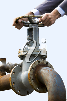 Close-up of metal steer held by male hands and pipe