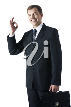 Vertical image of successful businessman looking at camera with smile