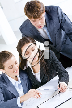 Portrait of three people working together in the office