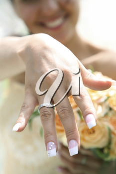 Close-up of bride�s hand with posh wedding ring showing it to you