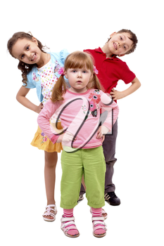 Portrait of smart girl standing before her happy friends over white background