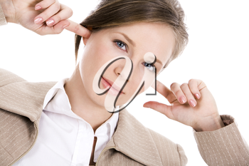 Image of pretty employee closing her ears with forefingers and looking at camerea with irritation