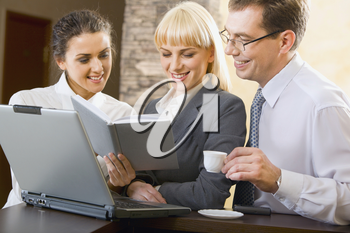 Confident business people are working together at meeting