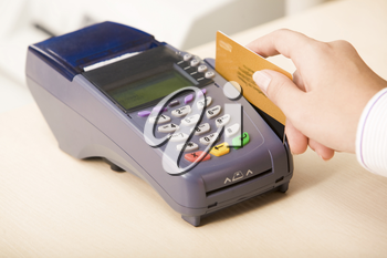 Photo of shop assistant�s hand with credit card during financial operation