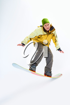 Portrait of young boy snowboarding and looking aside
