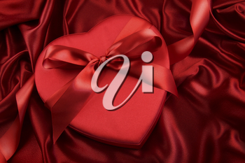 Royalty Free Photo of a Box of Chocolates on a Red Satin Background