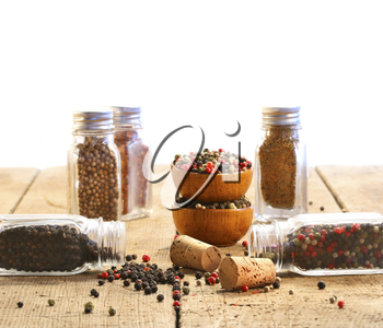 Royalty Free Photo of Spices in Glass Containers on a Wooden table