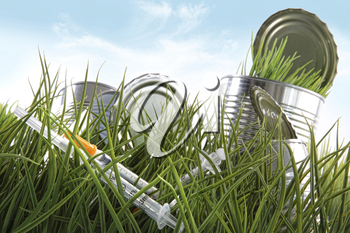 Royalty Free Photo of Syringes and Tin Cans in the Grass