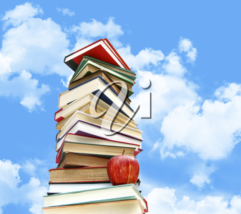 Royalty Free Photo of a Pile of Books With an Apple