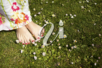 A shot of feet of a woman standing on the grass