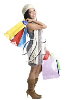 An isolated shot of a beautiful asian woman carrying shopping bags