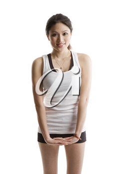 An isolated shot of a beautiful asian woman stretching before exercise