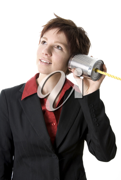 woman in a suit listening to a tin can phone