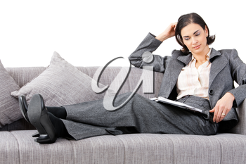 Young businesswoman sitting on sofa, working. Isolated on white background.