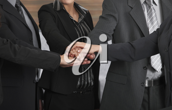 Closeup photo of joined hands of business team.
