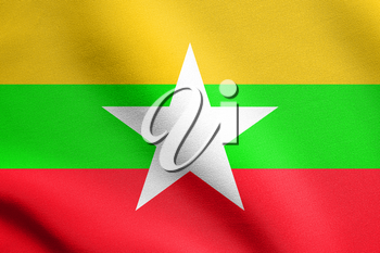 Flag of Myanmar waving in the wind with detailed fabric texture. Myanmar national flag.