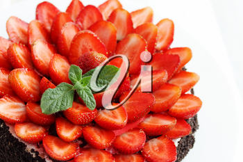 Chocolate cake decorated with fresh juicy strawberries
