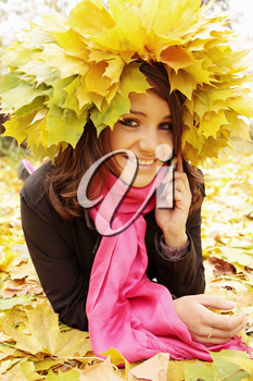 Woman in autumn wreath speaks on the phone