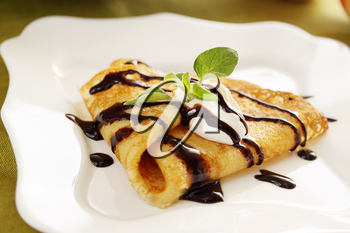 Pancake with sour cream and hot chocolate