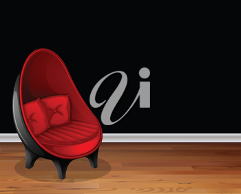 Red chair in front of black wall