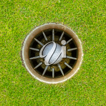 Hole in One - Golf ball in the cup