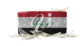 Brick with broken glass, violence concept, flag of Iraq