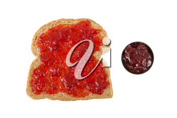 Slice of brown bread with jam isolated on white