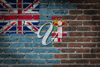 Very old dark red brick wall texture with flag - Fiji