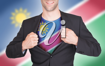 Businessman opening suit to reveal shirt with flag, Namibia