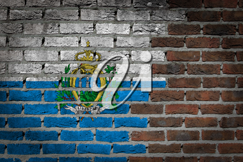 Very old dark red brick wall texture with flag - San Marino