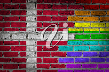Dark brick wall texture - coutry flag and rainbow flag painted on wall - Denmark