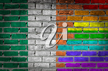 Dark brick wall texture - coutry flag and rainbow flag painted on wall - Ireland