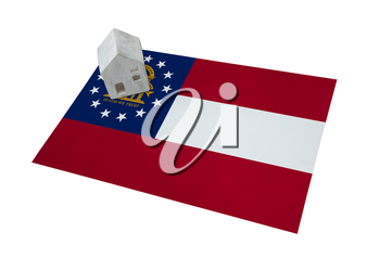 Small house on a flag - Living or migrating to Georgia