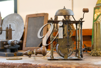 Old clock workshop, selective focus on the clock