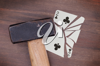 Hammer with a broken card, vintage look, two of clubs