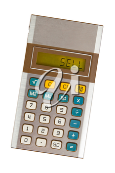 Old calculator showing a text on display - sell