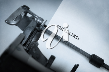 Vintage inscription made by old typewriter, Complaint