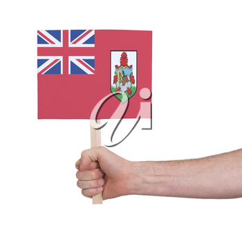 Hand holding small card, isolated on white - Flag of Bermuda