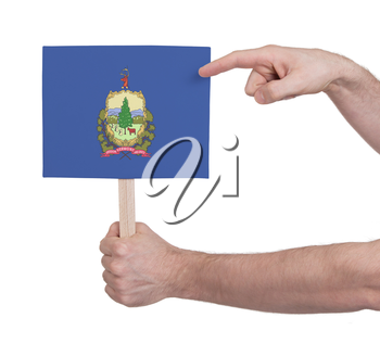 Hand holding small card, isolated on white - Flag of Vermont