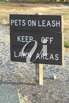 Stock Photo of a Pets On Leash Sign