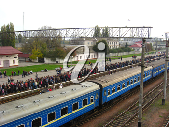 View to the people waiting for the electric train in the railway station