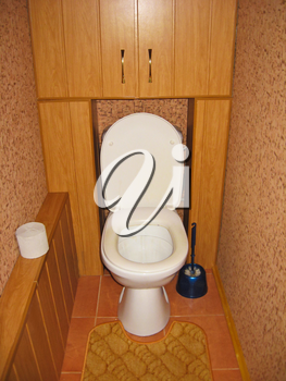 the image of white toilet bowl in brown toilet