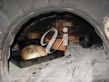 image of tasty ruddy easter bread cooking in the furnace