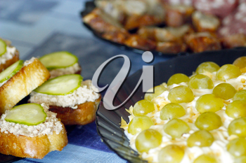 delicious toast with cod's liver and salad with green grapes